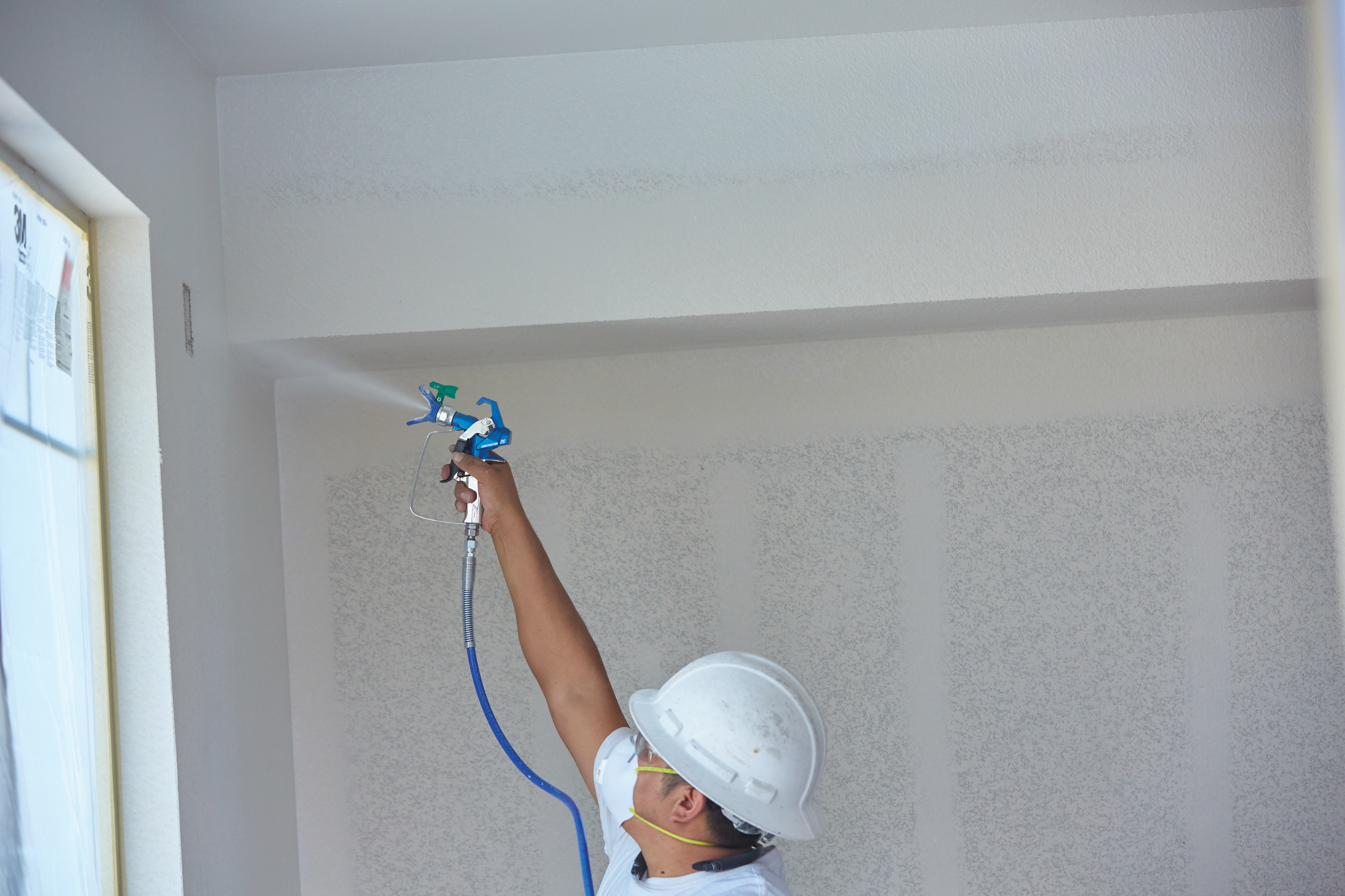 conrtactor pc gun from graco being used for painting