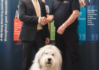 L-R Derek Whitehead, Principal of Leeds College of Building and Mark Rigby, Skills Development Consultant at Dulux Academy open the new Dulux Academy space with the Dulux Dog