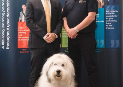 L-R Derek Whitehead, Principal of Leeds College of Building and Mark Rigby, Skills Development Consultant at Dulux Academy with the Dulux Dog